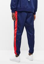 Nike - Nsw nsp pant wvn - blue & red