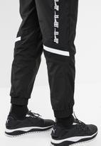 PUMA - Puma xtg woven pant - black