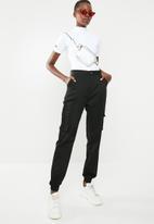 Missguided - High neck zip up short sleeve bodysuit - white