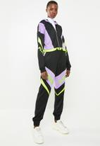 Missguided - Playboy shell suit motorcross cropped jacket - multi