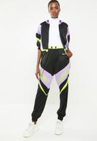 Missguided - Playboy shell suit panel trousers - multi