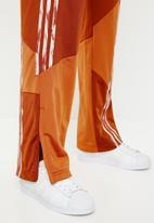 adidas Originals - Danielle cathari x adidas originals fire bird tracksuit pants - orange