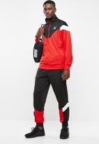 PUMA - Iconic mcs track jacket - red