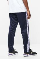 New Balance  - N pack track pant - navy