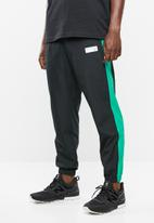 New Balance  - Archive windbreaker pant - black