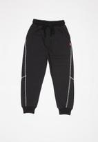 POP CANDY - Boys joggers with white stripe - black