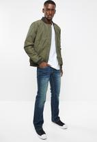 GUESS - Slim boot jeans - blue
