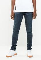 S.P.C.C. - Feather classic rinse jeans - blue