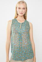 Revenge - Floral sleeveless top with front cutout - blue