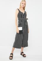 Revenge - V-front cut-out striped print jumpsuit - black & white