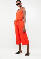 Revenge - V-front cut-out jumpsuit - orange