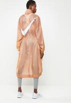 Nike - Woven swoosh jacket- rose gold
