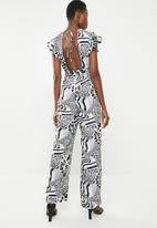 Revenge - Animal print jumpsuit with open back - multi