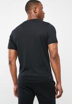 New Balance  - Tenacity heather short sleeve print T-shirt - black