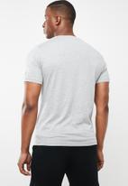 New Balance  - Tenacity heather short sleeve print T-shirt - grey