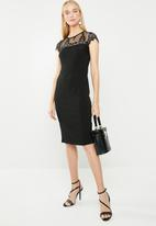 Revenge - Lace insert cocktail dress with lace cap sleeves - black