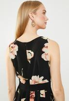 Revenge - Sleeveless floral dress with pleated skirt - multi