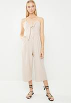 Revenge - Spaghetti strap jumpsuit with bow front - beige