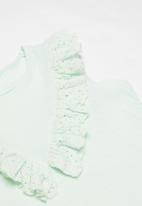 MINOTI - Tropicana dyed vest with embroidered anglaise fril - green