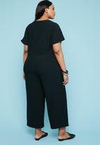 Superbalist - Button through jumpsuit - black