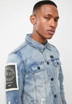 S.P.C.C. - Washed denim jacket - blue