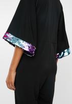 RUFF TUNG - Sequin trim twist jumpsuit - black