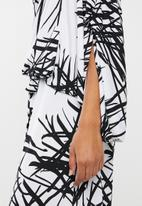 RUFF TUNG - One shoulder jumpsuit black & white