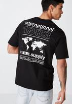 Cotton On - International 1983 tbar tee - black
