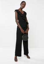 Revenge - Ruffle jumpsuit with tie waist - black