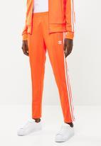 adidas Originals - SST trackpants - orange