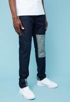 Superbalist - Regular fit tapered patchwork jeans - navy