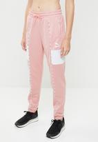 PUMA - Track pants - pink & white