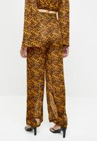 Missguided - Tortoise shell wide leg trousers - yellow