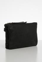 Escape Society - Leather cross body travel bag - black