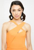 Missguided - Asymmetric cross-over flared leg jumpsuit - orange