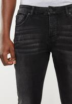 S.P.C.C. - Stencilled trench skinny jeans - black