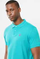 Pringle of Scotland - St Augustine styled golfer - blue