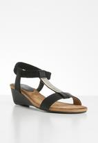 Butterfly Feet - Faux leather diamante low wedge sandal - black