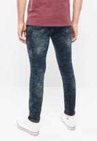 S.P.C.C. - Feather slim fit jeans - blue & black