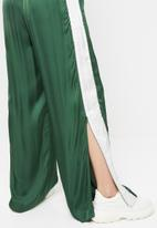 Diesel  - Rolen pantaloni wid leg pants - green & white