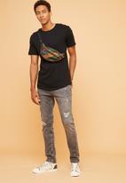Superbalist - Slim fit abrasions jeans - grey