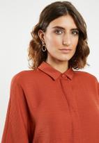 edit - Grown on sleeve shirt - rust