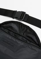 Reebok Classic - Reflective bag - black