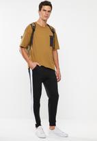 Superbalist - Skinny side stripe sweatpants - black & white