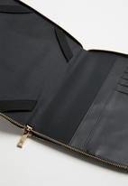 Call It Spring - Smartie tablet holder - pink & black