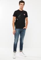 Diesel  - Sleenker-x 5 pocket skinny jeans - blue