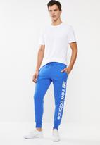 New Balance  - Optiks sweatpant - blue