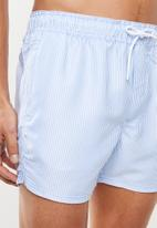 Cotton On - Striped swimming shorts - blue & white