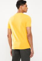 Dickies - Dickies horseshoe T-shirt - yellow
