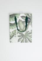 Typo - Stuff it bag small with tissue - varigated monstera